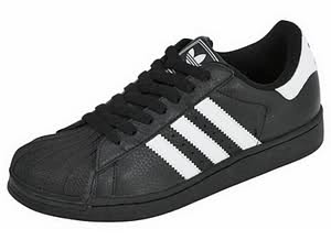 black adidas with white stripes